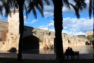 VALENCIA, Spain -- A couple embraces in the shade at Antiguo Cauce del Rio Turia.