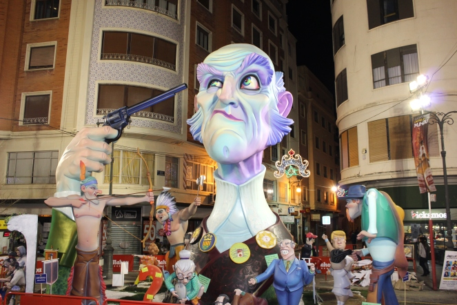 VALENCIA, Spain -- A sculpture of Uncle Sam playing Russian roulette at Las Fallas 2018. Donald Trump and Kim Jong Un dance in tutus at the bottom right.