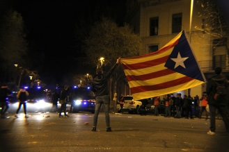 BARCELONA, Spain -- Catalan protestors wave flags and blow whistles in the streets of Barcelona after their Catalan president is arrested in Germany.